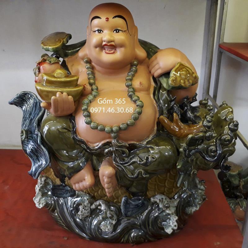 Tượng gốm sứ Bát Tràng - Tượng Phật Di Lặc cưỡi cá chép hóa rồng men xanh